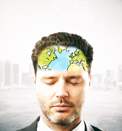 Portrait of thinking businessman with map on forehead. Abstract city background