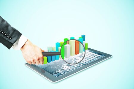 voluminous: Businessman hand holding magnifier over tablet with voluminous business chart bars. Market analysis concept. Light blue background. 3D Rendering