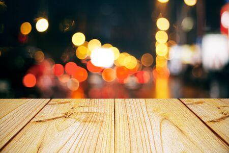 Empty light wooden surface on dark bokeh background. Mock up, 3D Rendering