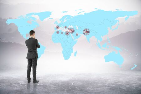 Thoughtful businessman looking at map with targets on abstract background. Geo targeting concept. 3D Rendering