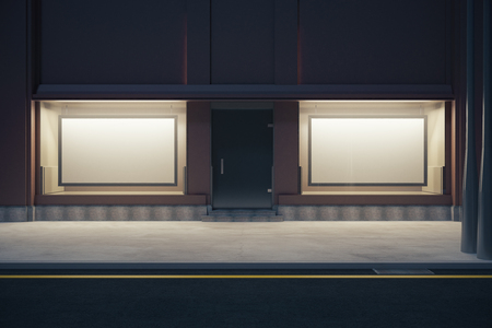 storefront: Front view of storefront with two empty billboards at night. Mock up, 3D Rendering