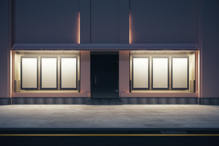 numerous: Front view of storefront with numerous empty posters at night. Mock up, 3D Rendering