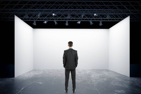 truss: Businessman in suit looking at empty truss stage. Back view, 3D Rendering Stock Photo