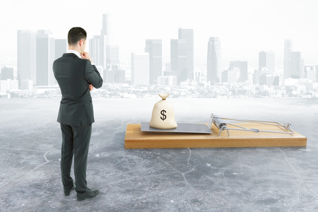 money sack: Business man looking at abstract mousetrap with money sack on city background. Risk concept. 3D Rendering
