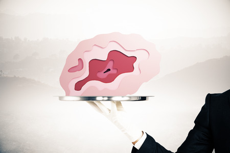 misty: Hand in glove holding abstract brain placed on silver tray on misty background. Brainstorming concept. 3D Rendering
