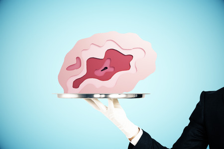 Hand in glove holding abstract brain placed on silver tray on blue background. Brainstorming concept. 3D Rendering