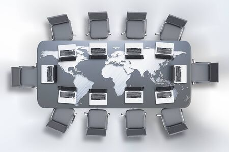 conference table: Top view of conference table with map and laptops on white background. 3D Rendering. Global business concept