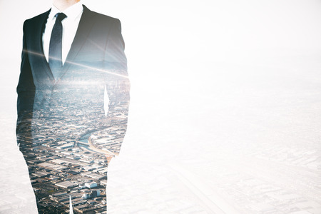 businesspersons: Closeup of businesspersons body in suit and tie on city background with abstract light. Double exposure