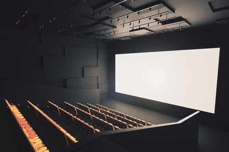 Side view of movie theater interior with rows of seats and blank white screen. Mock up, 3D Rendering Stock Photo