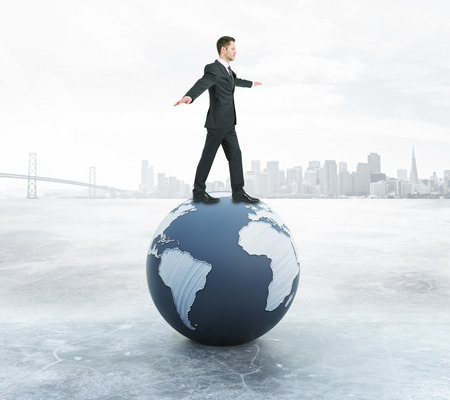 Young businessman in suit balancing on abstract globe. City background. 3D Rendering