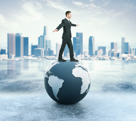 Young businessman in suit balancing on abstract globe. Modern city background. 3D Rendering Stock Photo