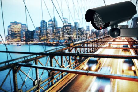 3D Rendering of a black CCTV security camera on contemporary city background with copy space