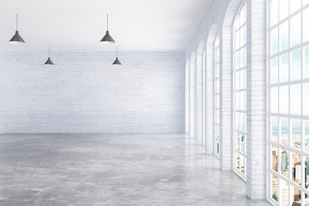 white window: Empty white brick and concrete interior with ceiling lamps and window with city view. 3D Rendering