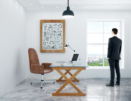 picture window: Young man looking out of window in modern office with workplace and business success sketch in picture frame. 3D Rendering