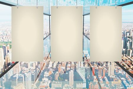 blank canvas: Three blank canvas hanging in abstract transparent glass room with city view. Mock up, 3D Rendering Stock Photo