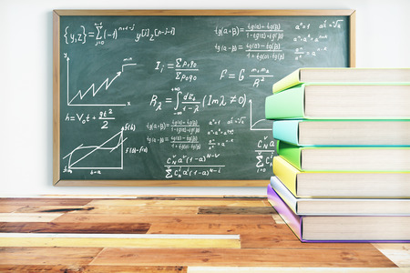 Education concept. Pile of colorful books on wooden surface and blackboard with mathematical formulas. 3D Rendering Stock Photo