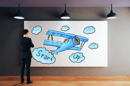 small plane: Thoughtful businessman in modern interior looking at whiteboard with creative small plane sketch. Start up concept. 3D Rendering
