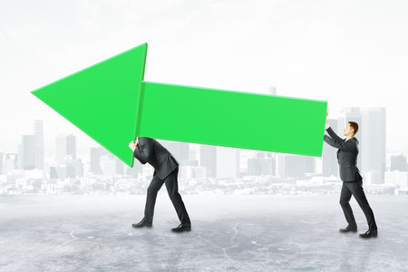 Two businesspeople carrying huge green business chart arrow on city background. Success concept, 3D Rendering