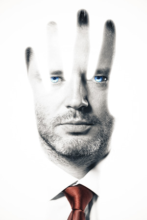 abstract portrait: Abstract portrait of handsome young businessman with tie and ice blue eyes on white background