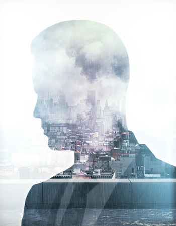 Thoughtful businessman silhouette on stormy city background. Research concept. Double exposure