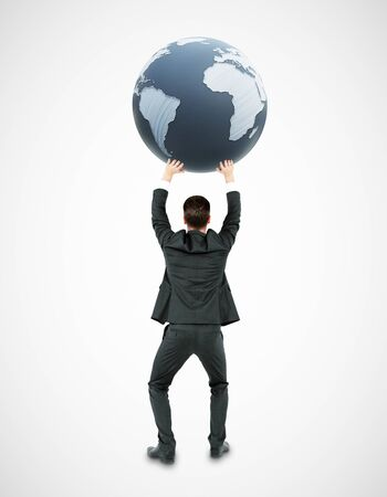 Back view of young businessman holding terrestrial globe on white background. 3D Rendering. International business concept Stock Photo