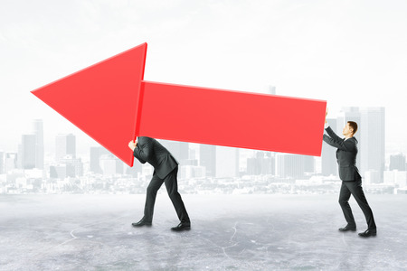 Two businesspeople carrying huge red business chart arrow on city background. Success concept, 3D Rendering