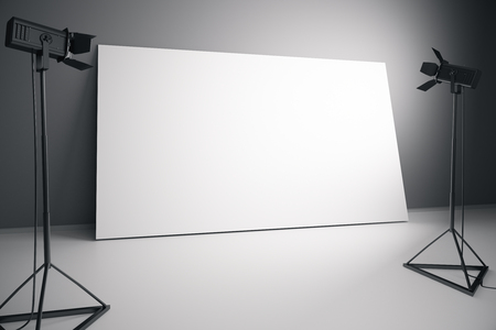 professional lighting: Concrete interior with blank white billboard and professional lighting equipment. Photo studio concept. Mock up, 3D Rendering