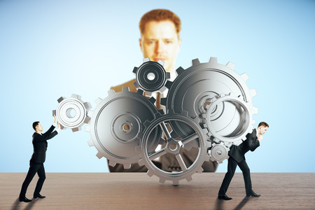 dragging: Two businessmen pushing and dragging abstract gear mechanism on blue background with another businessman watching them. Supervision concept. 3D Rendering