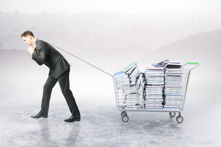 dragging: Businessman dragging trolley with heap of books on abstract background. Education concept. 3D Rendering