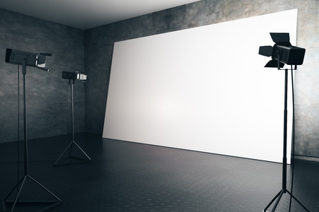 professional lighting: Concrete interior with blank white billboard and professional lighting equipment. Photo studio concept. Side view, Mock up, 3D Rendering Stock Photo