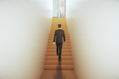 narrow: Back view of young businessman in suit climbing abstract narrow ladder leading to bright city. Success concept. 3D Rendering