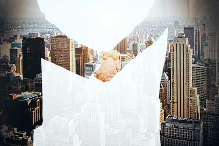 law suit: Businesspeople shaking hands on city background. Partnership concept. Double exposure