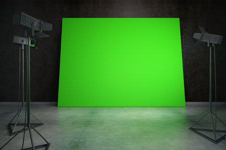 interior lighting: Concrete interior with blank green billboard and professional lighting equipment. Photo studio concept. Mock up, 3D Rendering Stock Photo