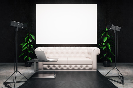 interior lighting: Front view of dark interior with blank billboard, white leather sofa, laptop on coffee table and professional lighting equipment. Mock up, 3D Rendering
