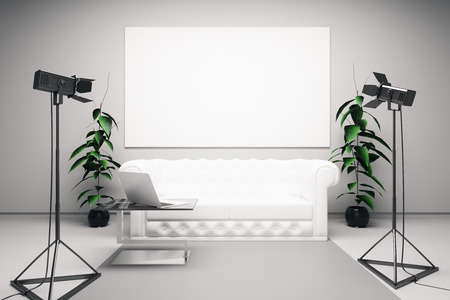 professional lighting: Front view of bright interior with blank billboard, white leather sofa, laptop on coffee table and professional lighting equipment. Mock up, 3D Rendering