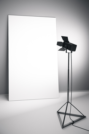 professional lighting: Concrete interior with blank white poster and professional lighting equipment. Photo studio concept. Mock up, 3D Rendering Stock Photo