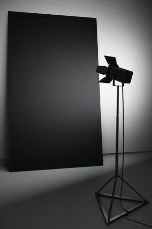 Dark interior with empty black poster and professional lighting equipment. Photo studio concept. Mock up, 3D Rendering