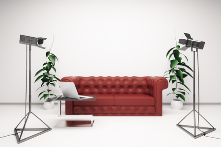 interior lighting: Front view of bright interior with blank white wall, red leather sofa, laptop on coffee table and professional lighting equipment. Mock up, 3D Rendering