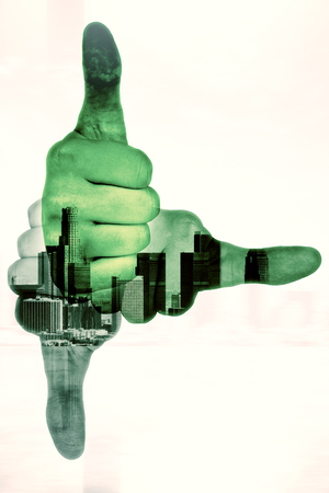 Three hands showing thumbs up and pointing to different directions on abstract city background. Double exposure