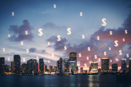 waterfront: Waterfront night city with creative dollar signs in the sky Stock Photo
