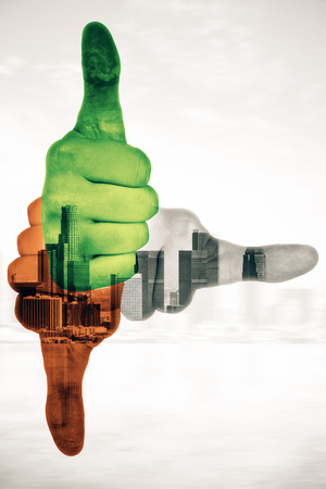 Three colorful hands showing thumbs up and pointing to different directions on abstract city background. Double exposure Stock Photo