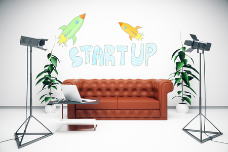 professional lighting: Studio with creative start up sketch, leather sofa, laptop and professional lighting equipment. Startup concept. 3D Rendering