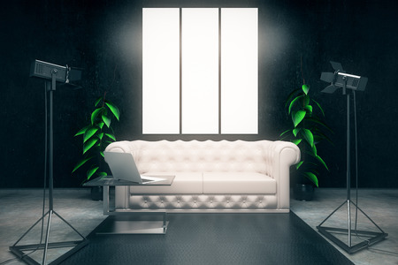 interior lighting: Front view of dark interior with blank posters, white leather sofa, laptop on coffee table and professional lighting equipment. Mock up, 3D Rendering Stock Photo