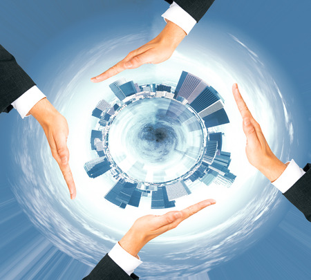 four hands: Four businessman hands around abstract circular cityscape Stock Photo