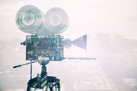 tripod projector: Retro movie camera on abstract city background. Side view. Double exposure. Cinema concept