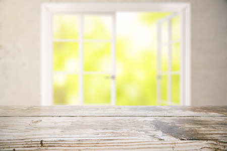 counter top: Close up of aged wooden surface on window with blurry green view background. Mock up, 3D Rendering Stock Photo