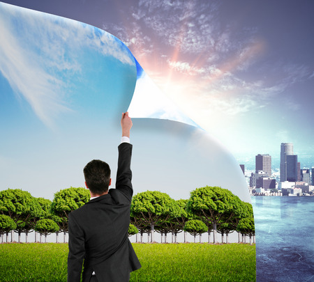 Abstract image of businessman flipping page with landscape, opening page with city. Urbanization concept