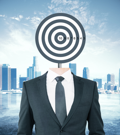 targeting: Target-headed businessperson on city background. Targeting concept