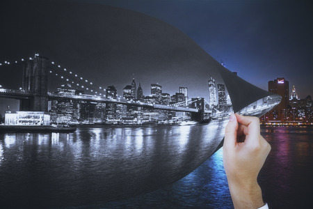 Abstract image of hand flipping city pages Stock Photo