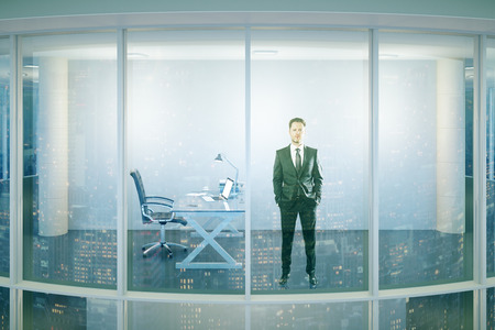 man standing alone: Businessperson looking out of window in modern glass office interior with workplace. Research concept. 3D Rendering